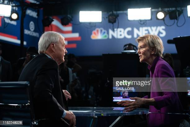 Democratic presidential hopeful US Senator from Massachusetts Elizabeth Warren with NBC anchor Chris Matthews in the Spin Room after participating in...