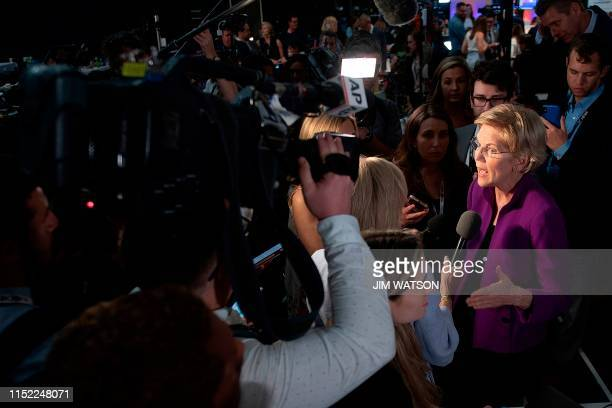 Democratic presidential hopeful US Senator from Massachusetts Elizabeth Warren speaks to the press in the spin room after participating in the first...