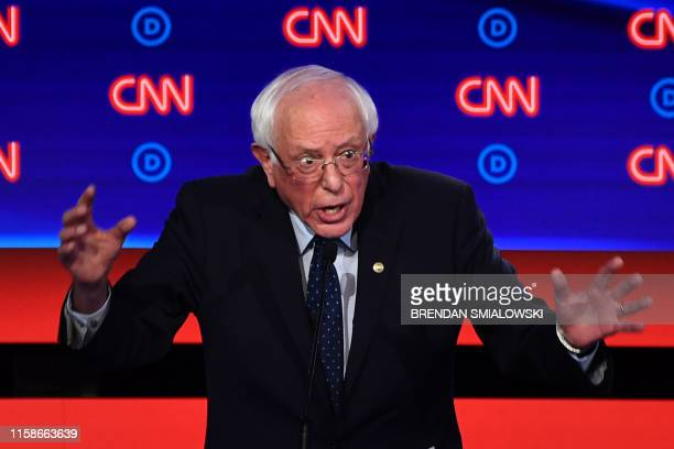 Democratic presidential hopeful US senator from Vermont Bernie Sanders gestures as he speaks during the first round of the second Democratic primary...