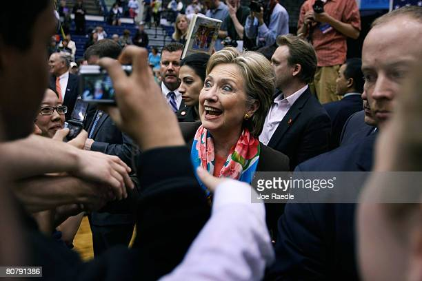 Democratic presidential hopeful US Senator Hillary Clinton shakes hands during a campaign rally on the campus of Pennsylvania State University April...