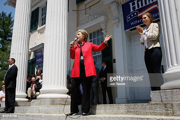 Democratic presidential hopeful US Senator Hillary Clinton speaks as her daughter Chelsea Clinton stands near her during a campaign event at Shepherd...