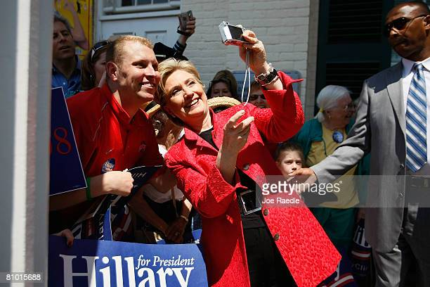 Democratic presidential hopeful US Senator Hillary Clinton takes a photograph with a supporter at Shepherd University McMurran Hall May 7 in...