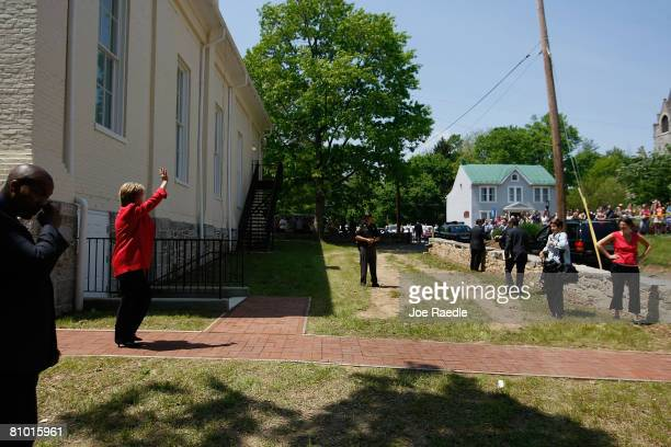 Democratic presidential hopeful US Senator Hillary Clinton waves to supporters as she leaves a campaign event at Shepherd University McMurran Hall...