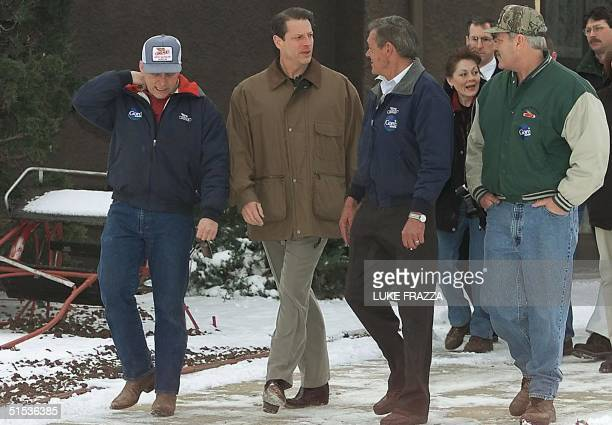 Democratic presidential hopeful US Vice President Al Gore walks with family farmers on the Menz family farm 21 January 2000 in Perry Iowa Gore is...
