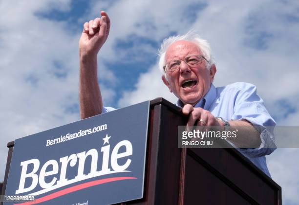 Democratic presidential hopeful Vermont Senator Bernie Sanders gestures as he speaks during a rally at Valley High School in Santa Ana California...