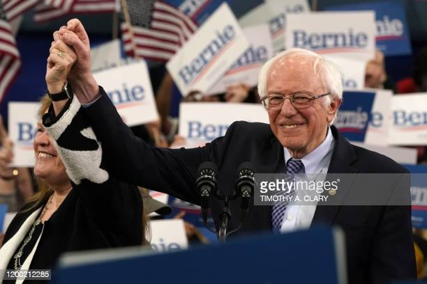 Democratic presidential hopeful Vermont Senator Bernie Sanders arrives flanked by his wife Jane O'Meara Sanders to speak at a Primary Night event at...