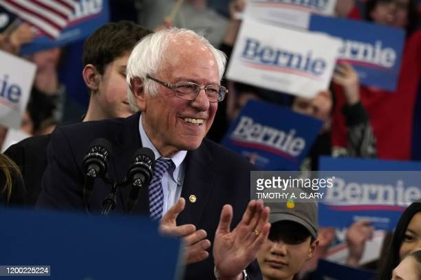 Democratic presidential hopeful Vermont Senator Bernie Sanders reacts as he speaks at a Primary Night event at the SNHU Field House in Manchester New...