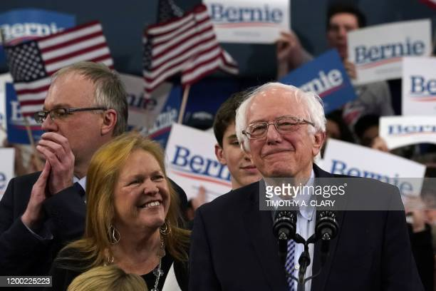 Democratic presidential hopeful Vermont Senator Bernie Sanders stands with wife Jane O'Meara Sanders at a Primary Night event at the SNHU Field House...