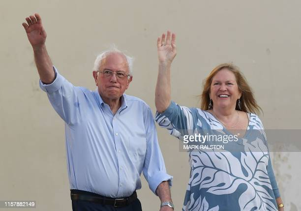 Democratic presidential hopeful Vermont US Senator Bernie Sanders and his wife Jane O'Meara Sanders arrive to speak to a crowd of supporters during a...