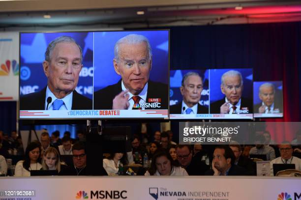 Democratic presidential hopefuls Former New York Mayor Mike Bloomberg and Former Vice President Joe Biden are seen on screens in a media room during...