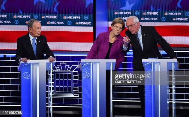 Democratic presidential hopefuls Former New York Mayor Mike Bloomberg watches Massachusetts Senator Elizabeth Warren and Vermont Senator Bernie...