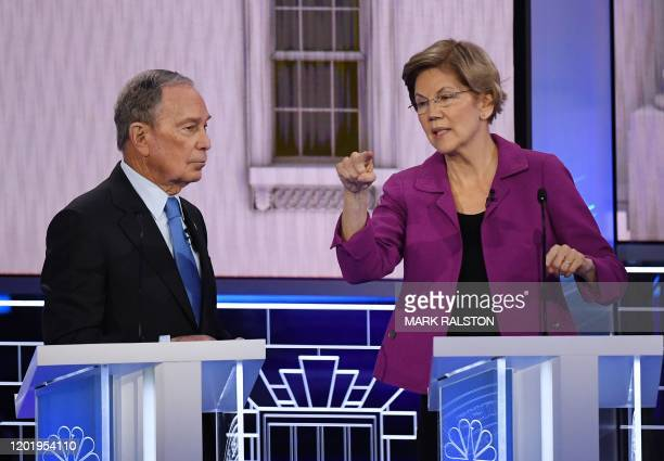 Democratic presidential hopefuls Former New York Mayor Mike Bloomberg and Massachusetts Senator Elizabeth Warren speak during a break in the ninth...