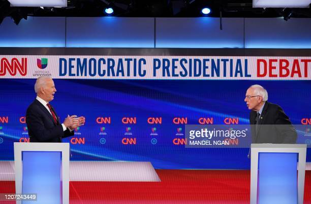 Democratic presidential hopefuls former US vice president Joe Biden and Senator Bernie Sanders take part in the 11th Democratic Party 2020...