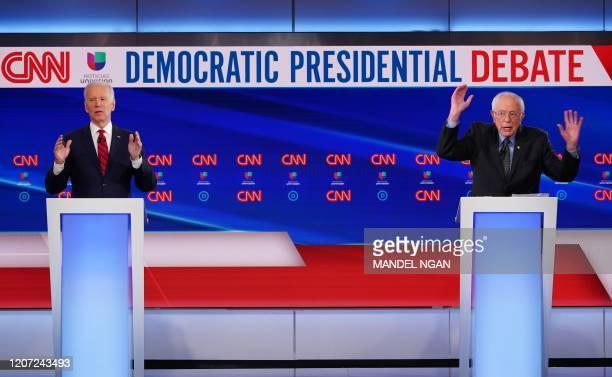 Democratic presidential hopefuls former US vice president Joe Biden and Vermont Senator Bernie Sanders take part in the 11th Democratic Party 2020...