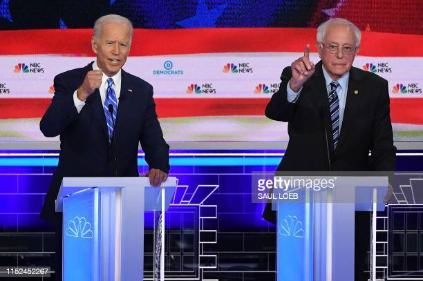 Democratic presidential hopefuls former US Vice President Joseph R Biden Jr and US Senator for Vermont Bernie Sanders speak during the second...