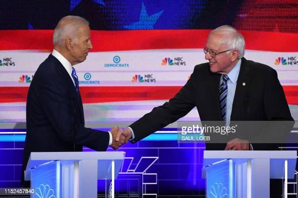 Democratic presidential hopefuls former US Vice President Joseph R Biden Jr and US Senator for Vermont Bernie Sanders shake hands after the second...