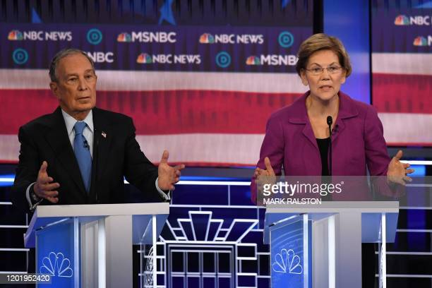 Democratic presidential hopefuls Massachusetts Senator Elizabeth Warren and former New York Mayor Mike Bloomberg gesture during the ninth Democratic...