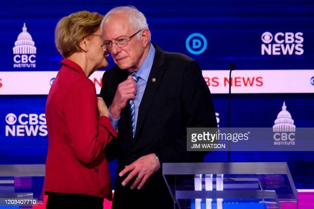 Democratic presidential hopefuls Massachusetts Senator Elizabeth Warren and Vermont Senator Bernie Sanders speak after the tenth Democratic primary...