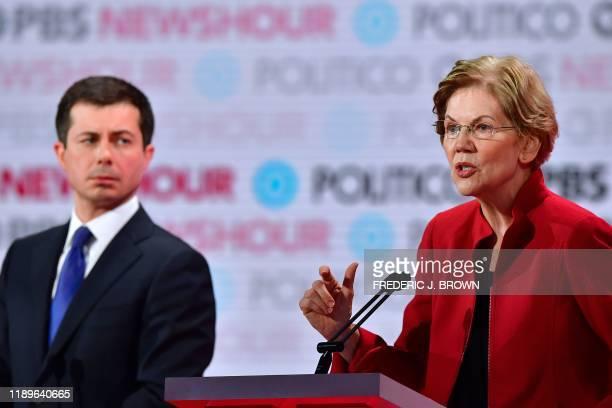 Democratic presidential hopefuls Mayor of South Bend Indiana Pete Buttigieg looks at Massachusetts Senator Elizabeth Warren as she speaks during the...