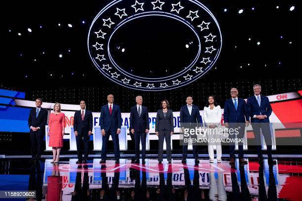 TOPSHOT Democratic presidential hopefuls US Senator from Colorado Michael Bennet US Senator from New York Kirsten Gillibrand former US Secretary of...