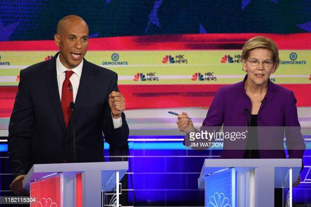 Democratic presidential hopefuls US Senator from Massachusetts Elizabeth Warren and US Senator from New Jersey Cory Booker participate in the first...