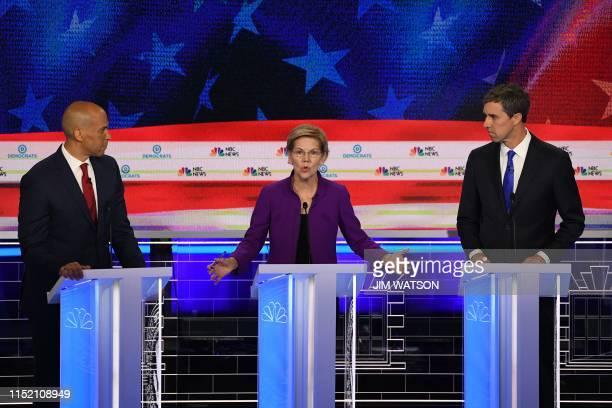 TOPSHOT Democratic presidential hopefuls US Senator from New Jersey Cory Booker US Senator from Massachusetts Elizabeth Warren and former US...