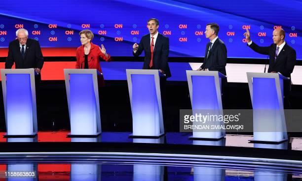 Democratic presidential hopefuls US senator from Vermont Bernie Sanders US Senator from Massachusetts Elizabeth Warren former US Representative for...