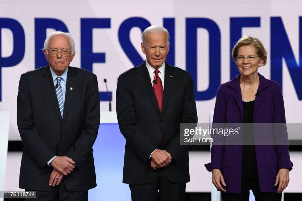 Democratic presidential hopefuls Vermont Senator Bernie Sanders former US Vice President Joe Biden and Massachusetts Senator Elizabeth Warren arrive...
