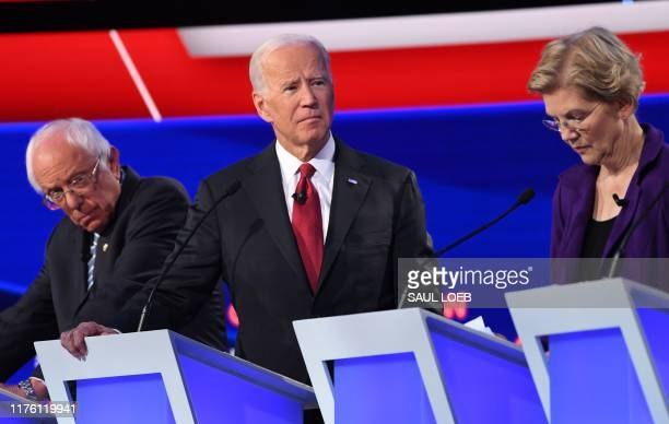 Democratic presidential hopefuls Vermont Senator Bernie Sanders former US Vice President Joe Biden and Massachusetts Senator Elizabeth Warren take...