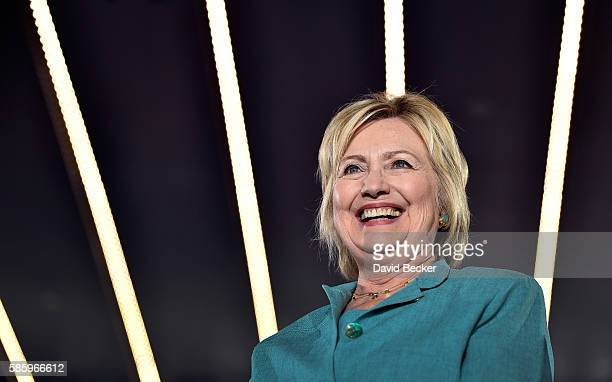 Democratic presidential nominee and former Secretary of State Hillary Clinton smiles before she speaks at the International Brotherhood of Electrical...