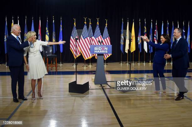Democratic presidential nominee and former US Vice President Joe Biden and his wife Jill Biden wave to his vice presidential running mate, US Senator...