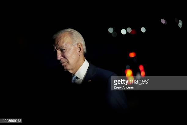 Democratic presidential nominee and former Vice President Joe Biden talks with local firefighters as he leaves a CNN town hall event on September 17,...