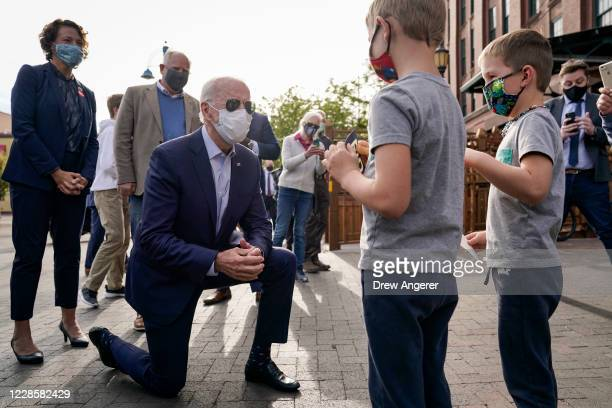 Democratic presidential nominee and former Vice President Joe Biden greets young children outside of Amazing Grace coffee shop on September 18, 2020...