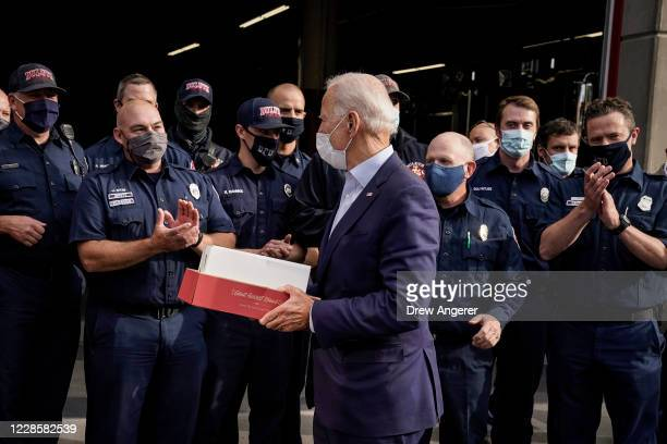 Democratic presidential nominee and former Vice President Joe Biden delivers cookies to members of the Duluth Fire Department at Engine House 1 on...
