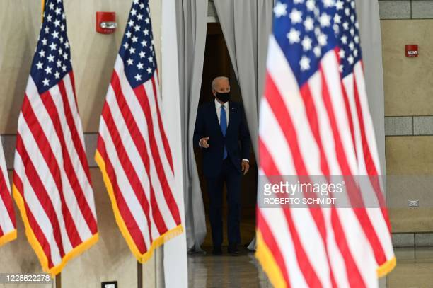 Democratic presidential nominee and former Vice President Joe Biden enters the hall at the National Constitution Center in Philadelphia, Pennsylvania...
