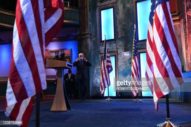 Democratic presidential nominee and former Vice President Joe Biden walks to the lectern to deliver a speech at a local theater in Wilmington...