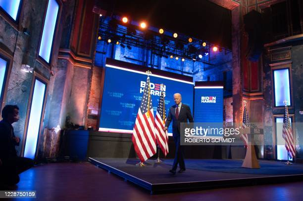 Democratic presidential nominee and former Vice President Joe Biden leaves the stage after speaking at a local theater in Wilmington Delaware on...
