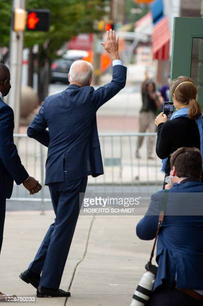 Democratic presidential nominee and former Vice President Joe Biden waves to a well wisher as he arrives at the Queen theater to make an announcement...