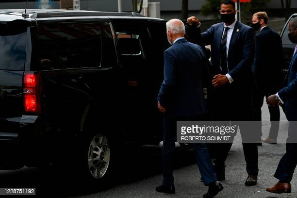 Democratic presidential nominee and former Vice President Joe Biden walks to a vehicle of this caravan after departing from a local theater after...