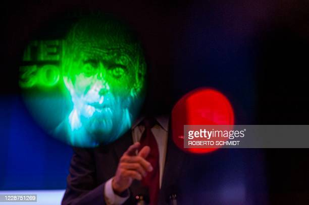 Democratic presidential nominee and former Vice President Joe Biden delivers a speech as seen through the viewfinder of a TV camera at a local...