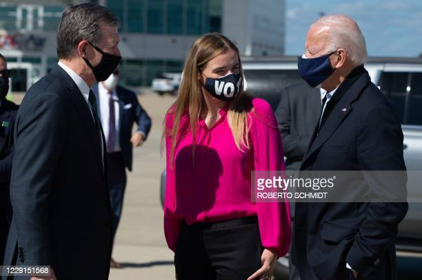 Democratic presidential nominee and former Vice President Joe Biden stands next to his granddaughter Finnegan as he greets the Governor of North...