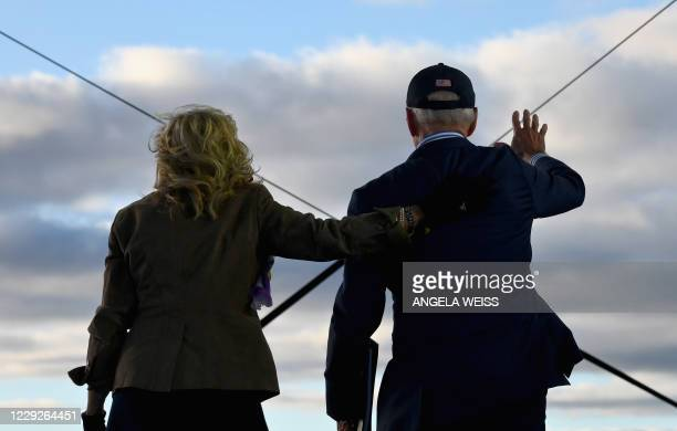 Democratic presidential nominee and former Vice President Joe Biden waves next to his wife Jill Biden after speaking at a Drive-In event with Bon...