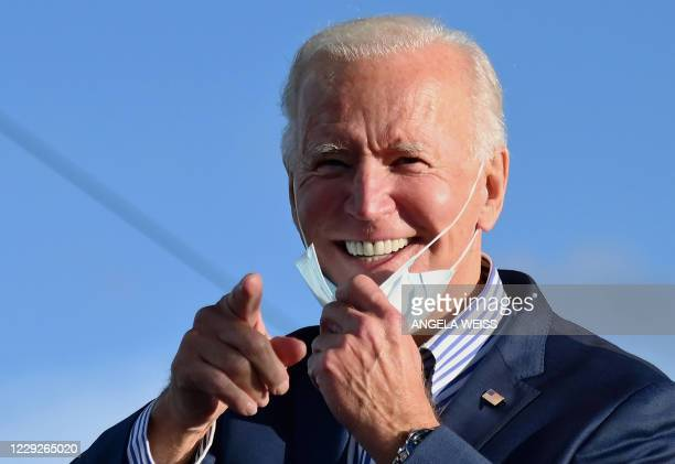 Democratic presidential nominee and former Vice President Joe Biden speaks at a Drive-In event with Bon Jovi at Dallas High School, Pennsylvania, on...
