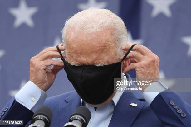 Democratic presidential nominee and former Vice President Joe Biden replaces the mask he wears to reduce the risk posed by coronavirus after...