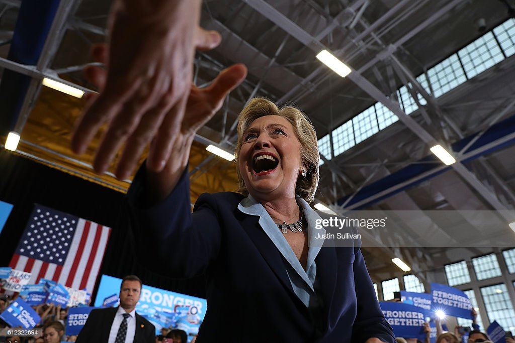 Democratic presidential nominee former Secreatry of State Hillary Clinton greets supporters during a campaign rally at Goodyear Hall and Theatre on October 3, 2016 in Akron, Ohio. Clinton is campaigning in Ohio ahead of the November 8th election.