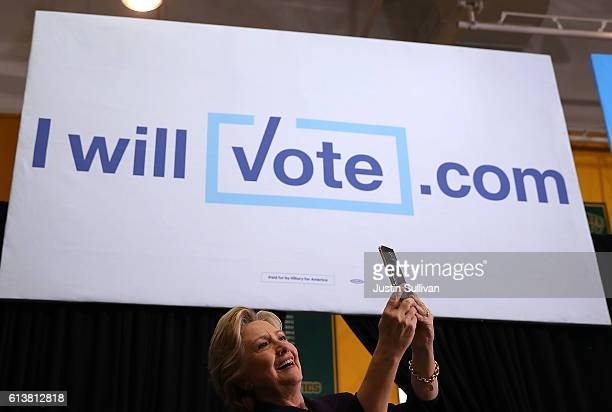 Democratic presidential nominee former Secretary of State Hillary Clinton takes a selfie with supporters during a campaign rally at Wayne State...