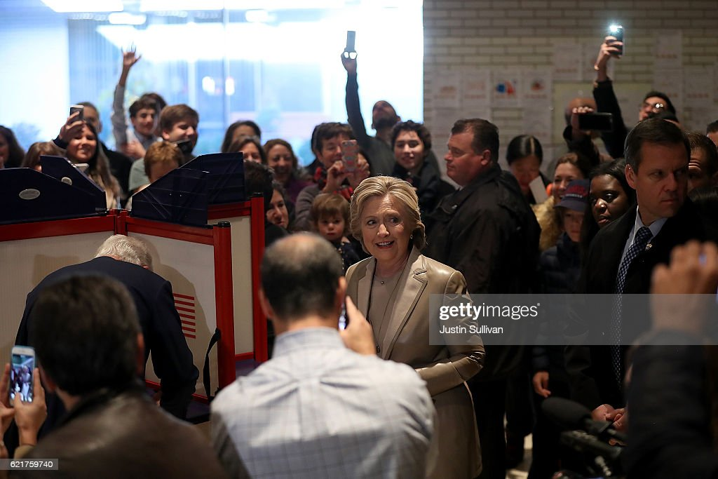 Democratic presidential nominee former Secretary of State Hillary Clinton is surrounded by people as she votes at Douglas Grafflin Elementary School on November 8, 2016 in Chappaqua, New York. Hillary Clinton cast her ballot in the presidential election as the rest of America goes to the polls to decide between her and Republican presidential candidate Donald Trump.