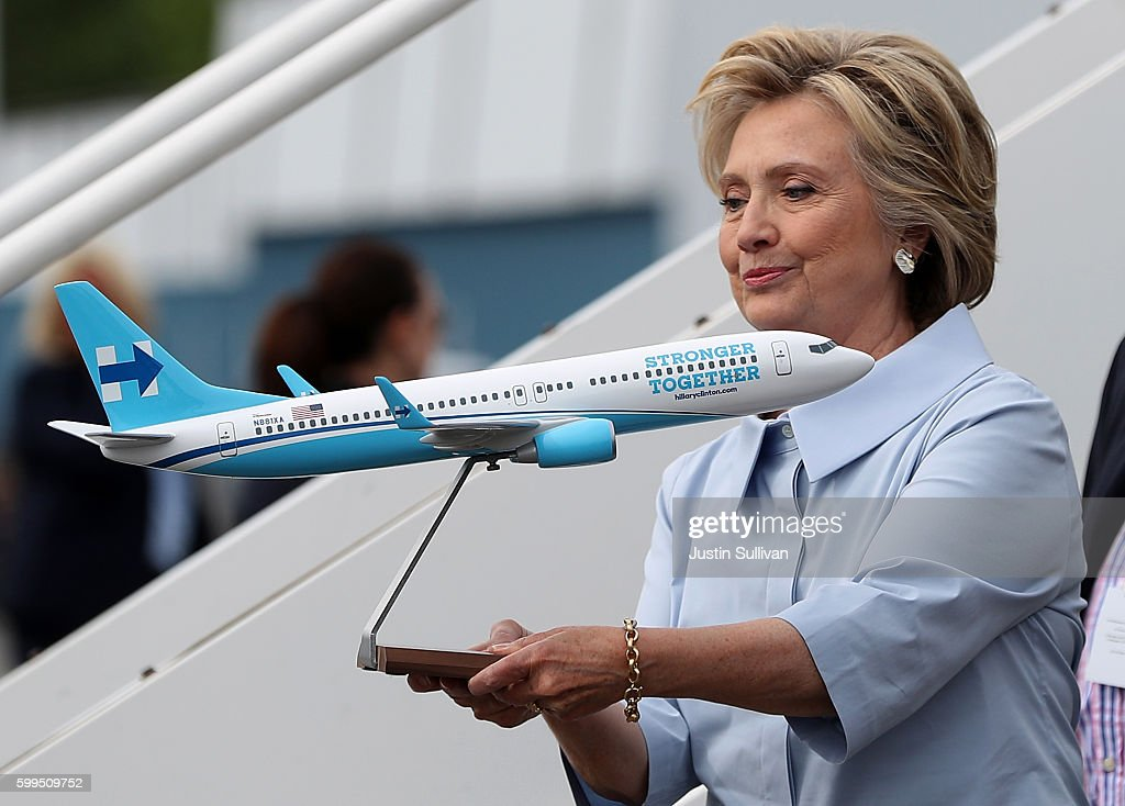 Democratic presidential nominee former Secretary of State Hillary Clinton looks at a scale model of her new campaign plane at Westchester County Airport on September 5, 2016 in White Plains, New York. Clinton is kicking off a Labor Day campaign swing to Ohio and Iowa on a new campaign plane large enough to accomodate her traveling press corp.