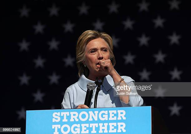 Democratic presidential nominee former Secretary of State Hillary Clinton coughs during a campaign rally at Luke Easter Park on September 5 2016 in...