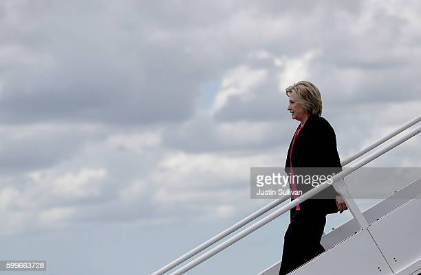 Democratic presidential nominee former Secretary of State Hillary Clinton walks off of her campaign plane at Tampa International Airport on September...